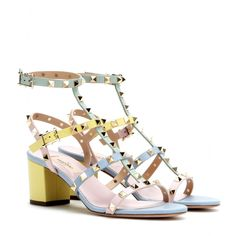 Valentino - Rockstud leather sandals - We can't get enough of the pastel hues from Valentino's SS15 collection. These block-heel leather sandals feature plenty of straps that are topped off with those classic pyramid studs. A more feminine take on the military trend, this pair works especially well with neutral hues. seen @ www.mytheresa.com
