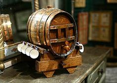 Calvados Barrel with 8 Majolica Cups