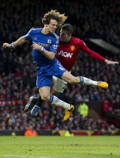 Luiz and RVP fight for a header