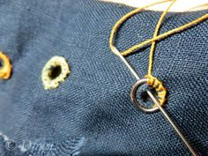 Hand-sewn eyelets. Gloucestershire Resource Centre http://www.grcltd.org/scrapstore/