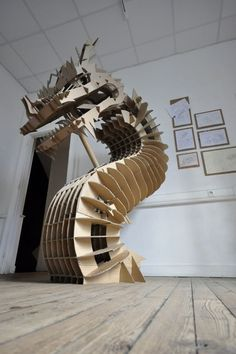 Oh. My. It's the Cardboard Dragon of my wildest paper crafting fantasies. CARDBOARD DRAGON by CHAé46 , via Behance: