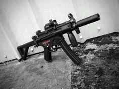 Hk MP5K with suppressor.