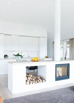Open kitchen layout with floating fireplace