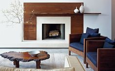 Love this modern/earthy look for the fireplace. possibility in family room? A modern fireplace instantly become a breathtaking focal point for any room, but with new advances in energy efficiency. See the best designs about fireplace ideas Wood Fireplace Surrounds, Fireplace Wall, Living Room With Fireplace, Fireplace Design, Fireplace Mantels, White Fireplace, Fireplace Ideas, Basement Fireplace, Fireplace Facade