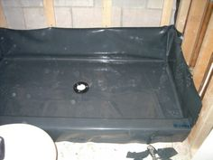 How to build a shower - Building a shower pan with pre-sloped mortar bed, liner and curb.