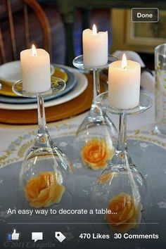 Old wine glasses, flip upside down, place flower inside, place candle on top.   Cheap easy centerpiece