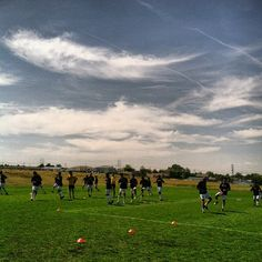 The team warming up before our second preseason game against Lethbridge. We won 3-0. Check out that Montana sky.