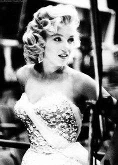 Such a beautiful expression on MM's face. Marilyn Monroe on the set of the Jack Benny Show, 1953.