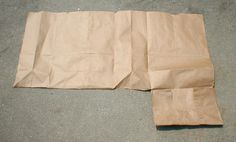 Forgot how to make one of those brown paper-bag book covers? These ten illustrated steps will jog your memory. Start by cutting the bag open.