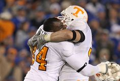 """""""I'd rather be a Tennessee Vol and lose every game than go somewhere else and win them all."""" - Wes Brown #94 (in picture with Chris Walker #84)"""