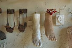 Replicas of feet and handicapped braces in ex-voto niche dedicated to the healed in Chapel of Saint Roch Cemetery. New Orleans, Louisiana, October 28, 2006