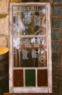 Wedding seating chart diagram made from weathered wooden window.