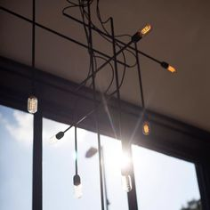 Bespoke lighting design by NinaCo for Saint Espresso coffee shop London  #light #lighting #design #interiors #interiordesign #chandelier #lightbulb #conduit #coffee  #coffeeshop #cafe