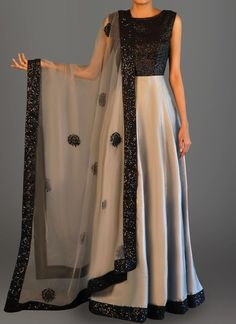 Black and Grey Sequins Embroidered Anarkali features a sequins bust alongside a taffeta silk flare, santoon inner and bottom alongside an embroidered net dupatta. Indian Fashion Dresses, Indian Gowns Dresses, Dress Indian Style, Indian Designer Outfits, Pakistani Dresses, Indian Outfits, Ethnic Outfits, Long Gown Dress, Lehnga Dress