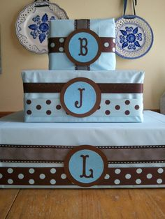 Thinking of doing this for the kids room to put a few of their things on! Wrapping Ideas, Gift Wrapping, Cruise Party, Cupcake Display, Old Boxes, Party Ideas, Gift Ideas, Glue Dots, Diaper Cakes