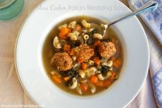 Easy Slow Cooker Italian Wedding Soup Recipe Soups with turkey meatballs, diced onions, baby carrots, chopped celery, crushed garlic, chicken broth, italian seasoning, ground black pepper, elbow macaroni, baby spinach leaves, grated parmesan cheese