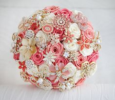 WeddingDressFantasy.com loves this.  Brooch bouquet Deposit on a Coral and Ivory by MagnoliaHandmade, $60.00