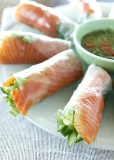 Smoked Salmon roll in rice paper.smoked salmon, cucumber, lettuce, mint, coriander and spring onion rolled in rice paper and served with a sweet chili dipping sauce.hearty appetizer or light lunch or dinner Fish Recipes, Seafood Recipes, Asian Recipes, Cooking Recipes, Salmon And Rice, Salmon Roll, Salmon Spring Roll Recipe, Salmon Wrap, Healthy Snacks