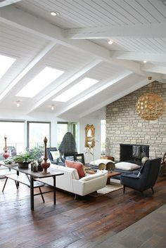 mid century modern attic living room with boho touches