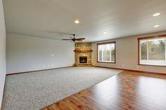 Corner fireplace with a raised hearth and shelf hemlock mantle. #greatnwhomes #artazumphotgraphy