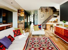 Modern living room with red accents and tribal prints