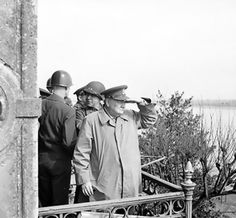 Winston Churchill and American generals on a balcony watching Allied vehicles crossing the Rhine River into Germany, 25 Mar 1945. (Imperial War Museum)