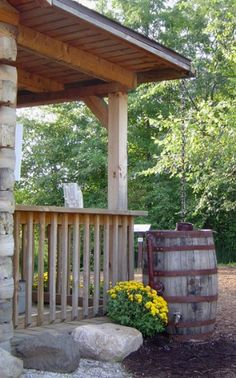 Repurposed wine barrel ---> rain barrel......great for being green :)