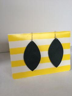 Hand cut leather leaf earrings by QuilterDesigns on Etsy