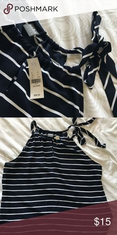 Ny&Co XXL Navy & White striped shell BNWT never worn. Super cute keyhole opening, side tie on the shoulder. Lots of great little details in this piece. Adorable paired with red cardigan👌🏽 New York & Company Tops Camisoles