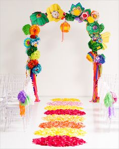 wedding ceremony ideas by bows and arrows. arch with paper poms, fans, pinatas, and lanterns.