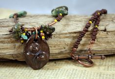 What a Fungi Necklace by CraftyHope, via Etsy.