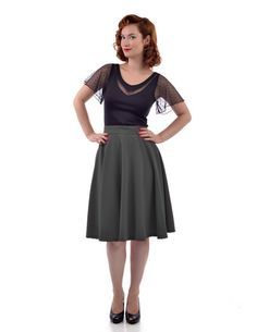 Flutter around like Lucille Ball in this flirty skirt. Made with stretchy draping fabric, it's one of those basic circle skirts every good retro aficionado should have! Universally flattering with its cut and fabric, it can really fit anybody. For those worried about length, throw on a pair of heels! Not only will you get the desired length, you'll instantly glam up your look. No matter what your height, this skirt looks fabulous even with a pair of cute flats! You'll just want to tw...