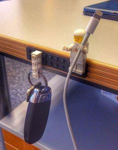 Use a #Lego character to keep you cables tidy, the hands make perfect grips for cables. Be tidy and fun all at once! #lifehacks