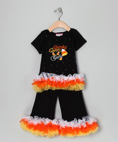 Any little princess will sparkle in this terrific set. With the tee's lap neck and blingin' embellishments, the pants' elastic waistband and all that ruffled trim, this getup dazzles with playful pizzazz.