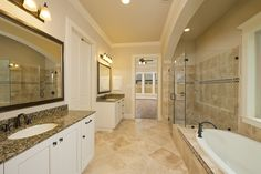 Estate Series Oak Forest Home Ready For Move-In - 4,294 Sq. Ft. - Master Bathroom  #PerryHomes #trustedbuilder #Houston #HoustonHomes #grandhomes #homebuilding #homebuying #OakForest #realestate #openconcept #openfloorplan #luxuryhomes #Intown #IntownHouston #DowntownHouston #relocatingtohouston #energycorridor #HoustonGalleria #HoustonMemorialPark #TheHeights #HoustonHeights #mastersuite #masterbath #masterbathroom #masterretreat #tilefloor #gardentub