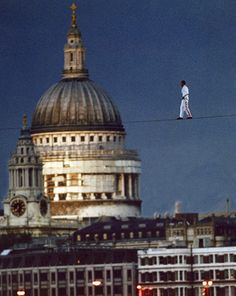 The last acrobats to cross the river by tightrope were Frenchman Didier Pasquette and American Jade Kindar-Martin during the first ever Thames Festival in 1997 World Records, Paris Travel, Vintage Pictures, Thought Provoking, Great Britain, Festivals, Jade, Cathedral, River