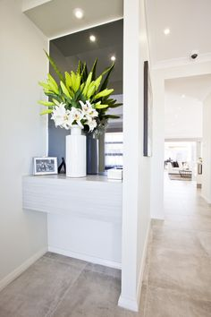 Add a dash of colour and a fresh feel to your hallway recesses with well-positioned flowers. Love this design? View the Essington floor plan at http://www.mcdonaldjoneshomes.com.au/home-designs/new-south-wales-and-queensland/essington/floorplans #mcdonaldjones #mcdonaldjoneshomes #simpleflowerarrangements