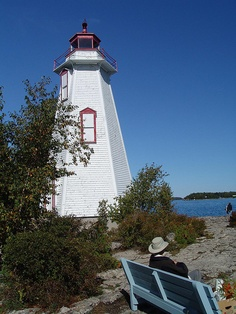 The lighthouse at Tobermory, Ontario. (Big Tub)    In 1885, the Department of Marine and Fisheries bought three lots at the entrance to the Big Tub Harbour for a lighthouse. In the 1870's, Charles Earl, one of the first settlers in the township, hung a lantern on a tree where the lighthouse was later built. Earl's lantern guided ships into the Big Tub Harbour where they could take refuge from storms and high seas.