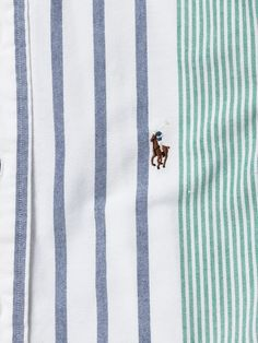 Multicoloured stripe cotton shirt from Polo Ralph Lauren with buttoned soft point collar and signature chest logo. The banker stripe goes tonal with this fresh interpretation of the label's signature striped shirt.