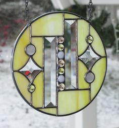 """7 1/4"""" Lemon Yellow Stained Glass Window, Round, with Bevels and Glass Gems. This is pretty but I'd love in red!!"""