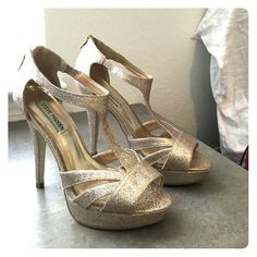 Steve Madden Golden Glitter Heels Size 7.5 glittered heels. Worn once, slight ware on soles. 1 inch platform, 5 inch heels. Perfect for a night out on the town! Steve Madden Shoes Heels