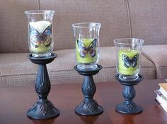 Make an elegant statement with metal-look candle sticks, candles in hurricane style vases and butterfly window clings.