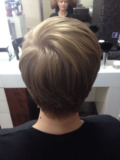 After photo of a short graduated haircut, cut around her ears and texturised all over