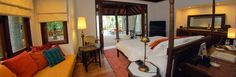 Staying at Anantara Kihavah Villas Maldives: Bedroom With Orange Sofa Bed In Anantara Kihavah Villas