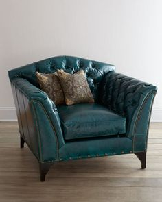 Old Hickory Tannery Montana ChairLeather is a rich peacock color (deep blue-green) with tufted inside back and arms and nailhead trim.
