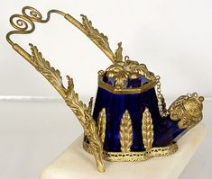 """Teakettle Ink With Stand - white stone base, fancy metal pen holder, very ornate metal leaf decoration on a blue glass inkwell.  Base measures 2-5/8"""" x 3-3/4""""."""
