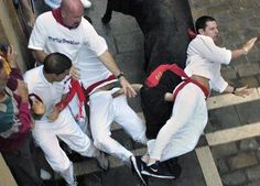 U.S. brothers Michael, right, and Lawrence Lenahan are gored at the same time by a fighting bull during a traditional bull run in Pamplona, Spain, Thursday July 12, 2007. The two brothers were gored Thursday during the longest and bloodiest morning bull run at the San Fermin festival in the northeastern city of Pamplona. Lawrence Lenahan, 26, of Hermosa Beach, Calif. and Michael Lenahan, 23, of Philadelphia, Pa. were gored by a bull who strayed from the pack, turned around and ran the wrong…