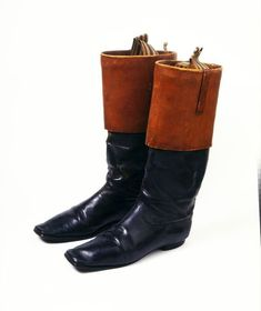 "1840s British Boots at the Victoria and Albert Museum, London - From the curators' comments: ""Top boots ended just below the knee. They are so called because the top was turned down to reveal a softer or lighter coloured leather, allowing greater mobility when riding and walking. They had leather or string loops on the inside to help with pulling them on. Top boots came into fashion during the 18th century."""