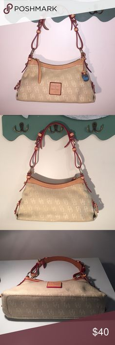 """💕Dooney & Bourke💕Tan Canvas w Red Trim 💕Dooney & Bourke💕Tan Canvas w Red Trim Small Bag  Excellent Condition inside & Out )one tiny stain see 2nd pic upper right corner not noticeable when carrying). 11"""" W X 5 1/2"""" H 9"""" Strap Drop can adjust shorter with buckle on strap Dooney & Bourke Bags Shoulder Bags"""
