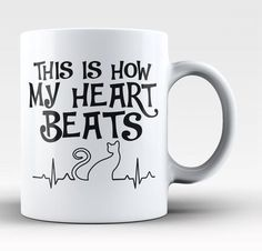 This is how my heart beats. The perfect coffee mug for cat lovers. Available here - https://diversethreads.com/products/cat-heart-beat-mug